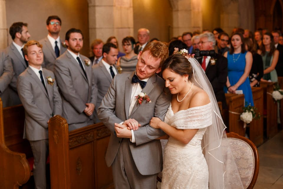 Wedding couple praying together in church