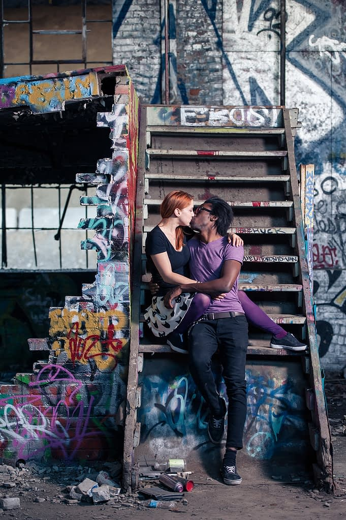 Urban engagement photoshoot in graffiti covered building