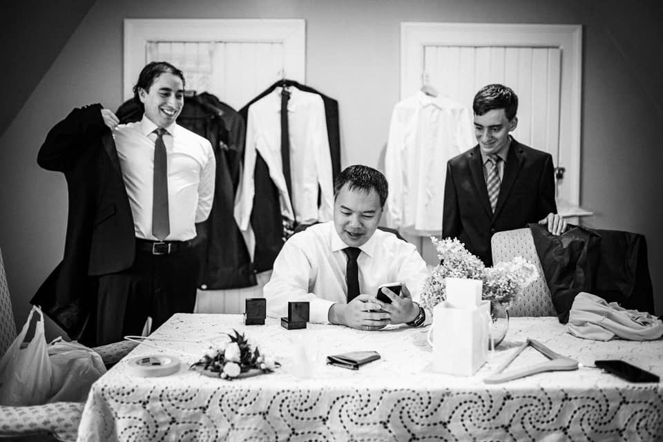Groom and friends getting dressed