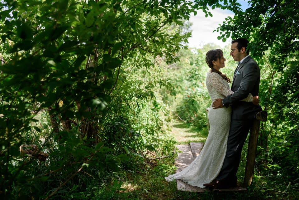 Wedding portrait surrounded by greenery at Auberge des Gallant