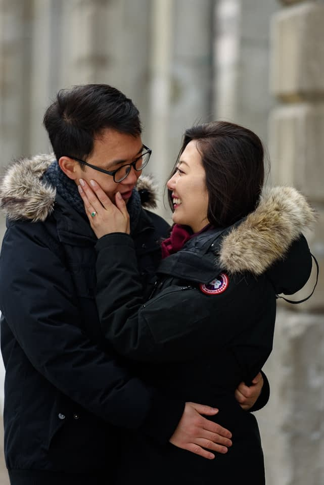 Happy engaged couple embracing in Old Montreal