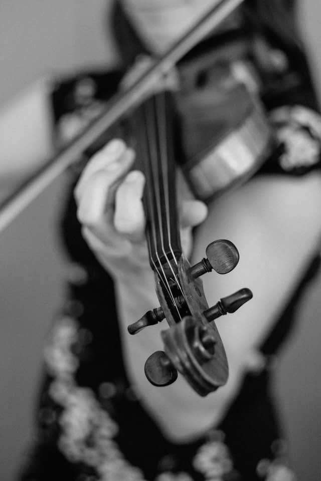 Black and white photo of wedding musician playing