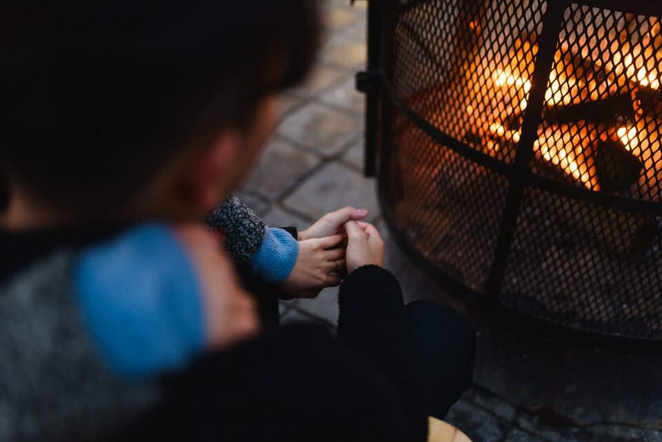 Cozy cuddling by an outdoor fire pit in Old Montreal