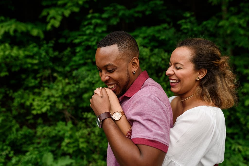 Engagement photo of couple kissing hands