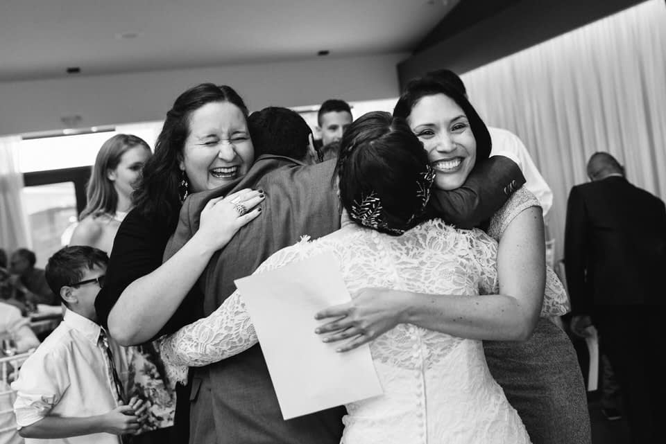 Hugs from cousins for the bride