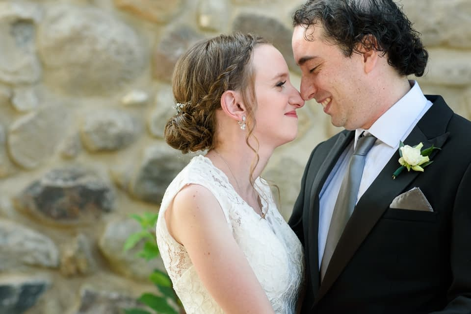 Close up of bride and groom nose to nose smiling