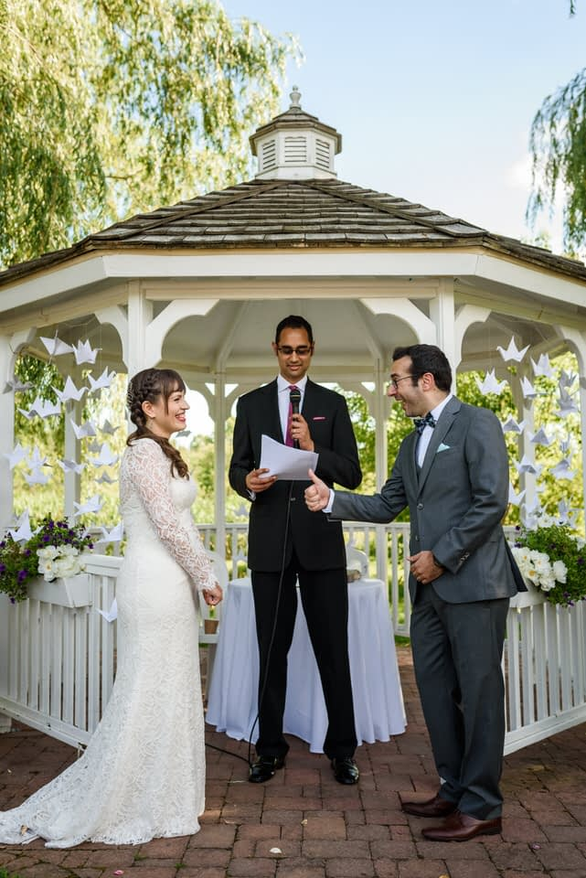 Groom giving thumbs up to bride at wedding at Auberge des Gallant
