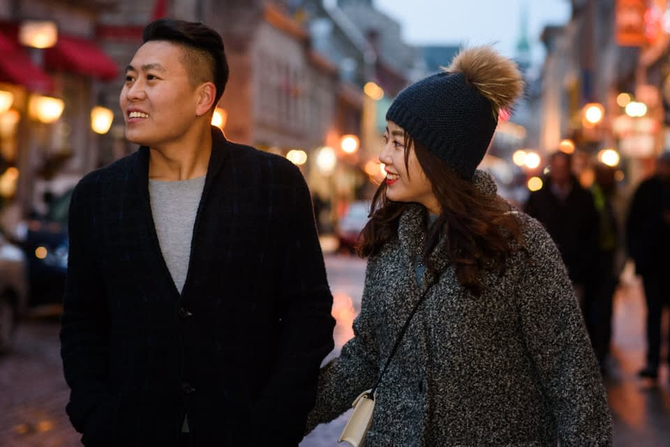 Man and woman strolling in Old Montreal in winter