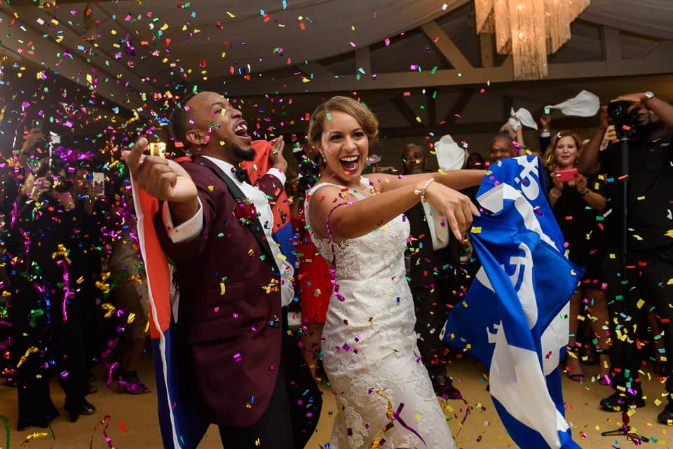 Bride and groom dancing with confetti and flags at Chalet des Erables wedding