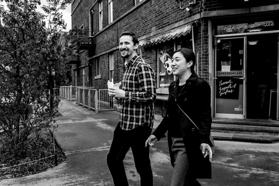 Couple vacation photoshoot in Montreal with snacks in Mile-End