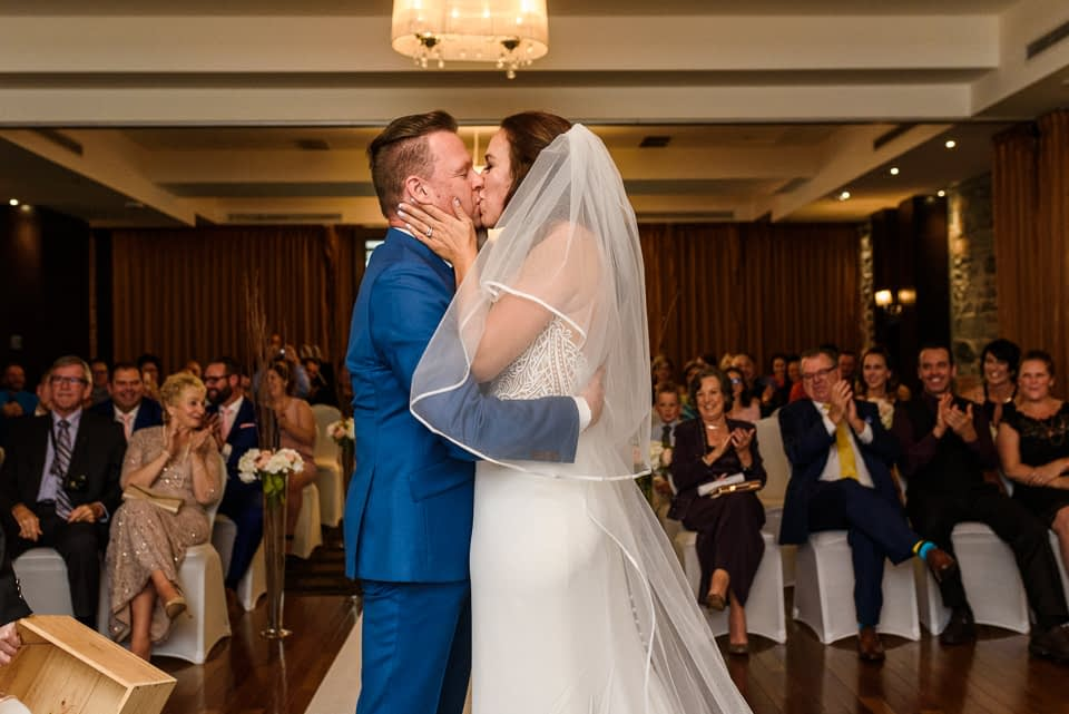 First kiss at wedding ceremony at Hotel Nelligan