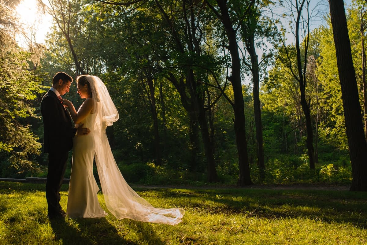 Wedding couple in the setting sun in woods