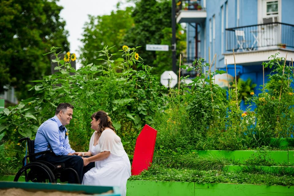 Colourful wedding portrait of couple sitting near Else's bar