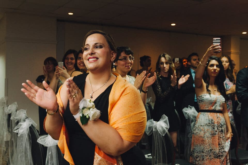 Guest clapping during ceremony