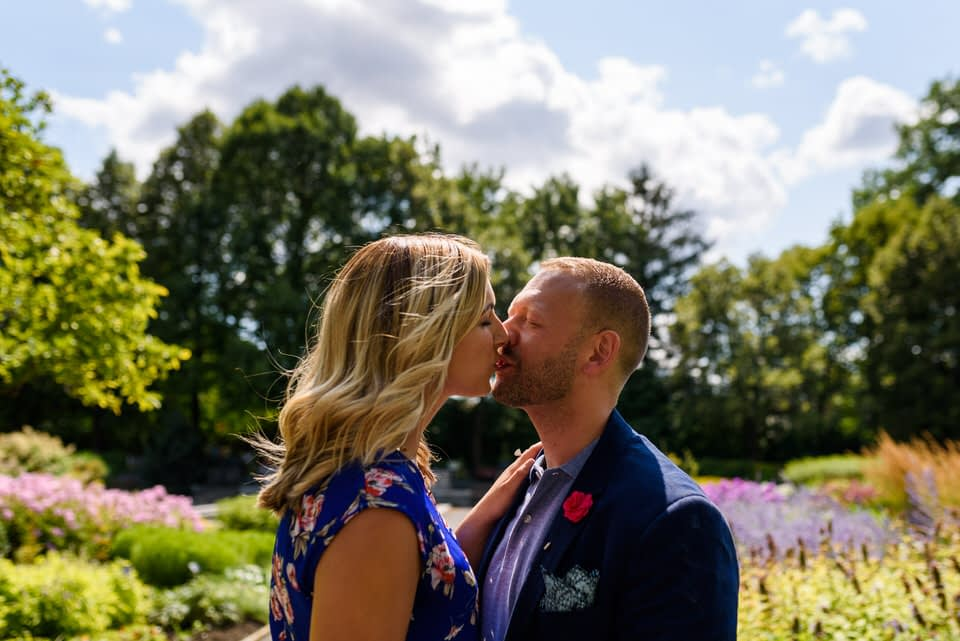 Couple kissing in the middle of flowers