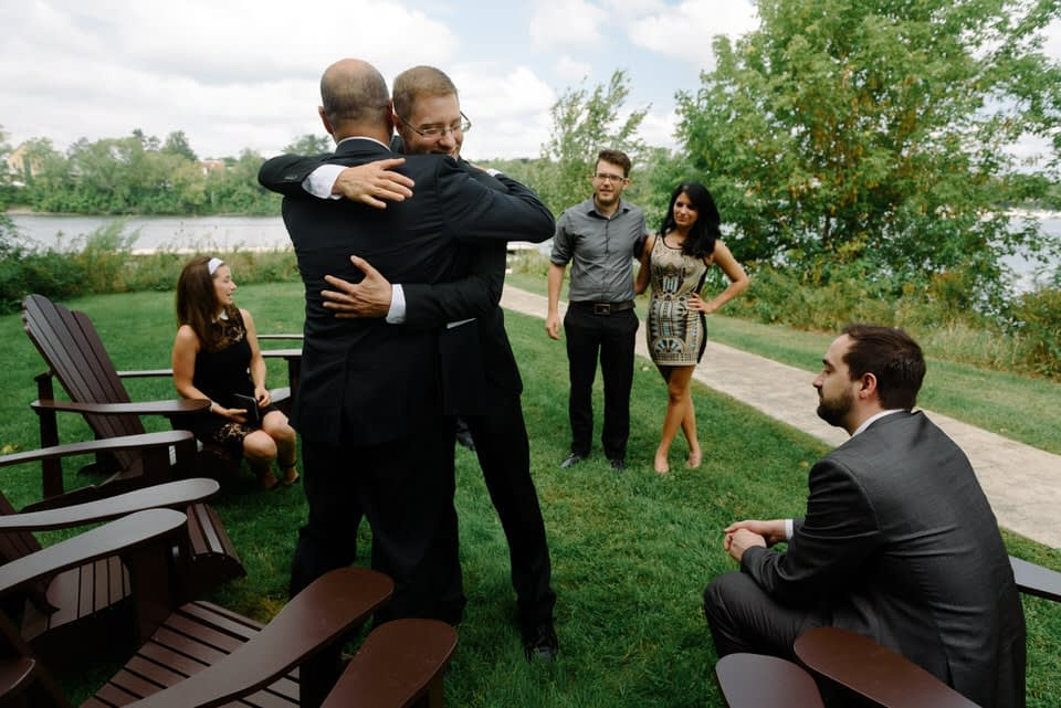 Wedding guests greeting each other