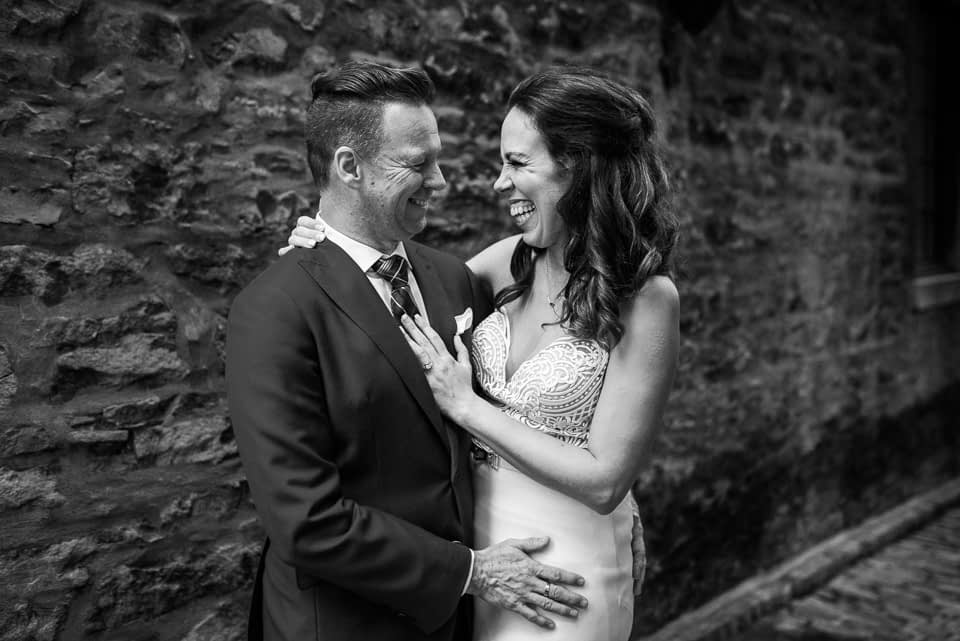 Black and white photo of bride and groom in Old Montreal