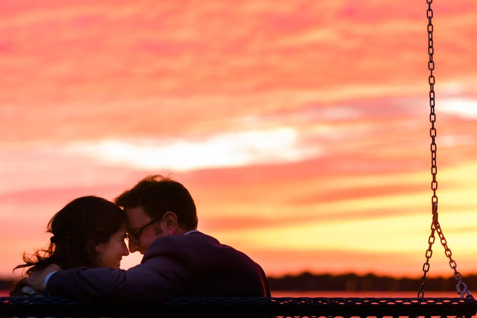 Happy newly engaged couple after sunset surprise proposal