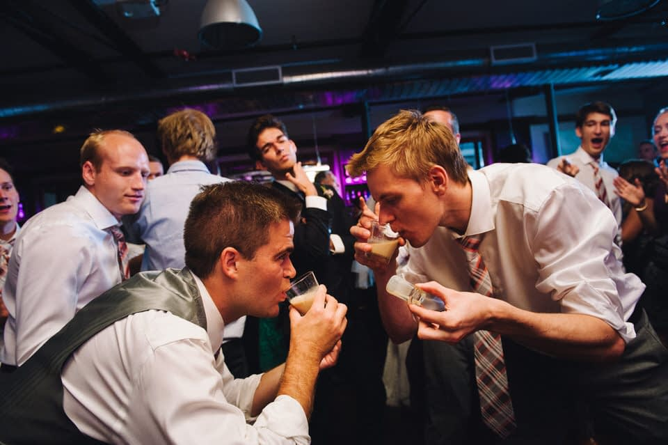 Groom and friend doing a shot