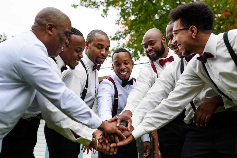 Groom cheering with his friends