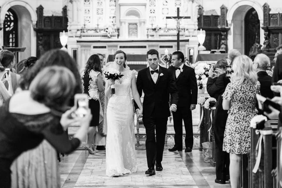 Just married wedding couple walking down the aisle