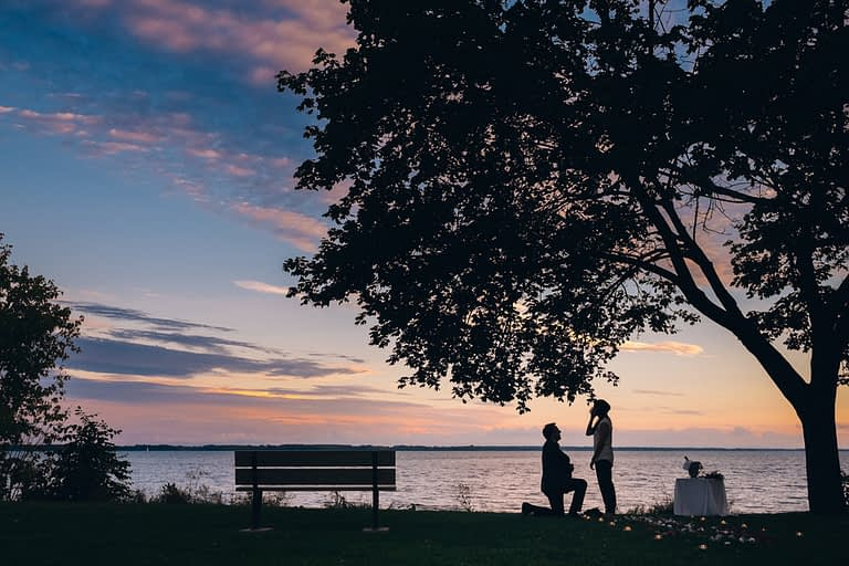Sunset surprise proposal photography by the Saint-Lawrence river