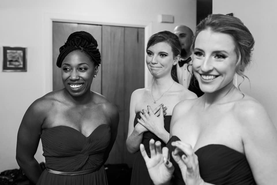 Emotional bridesmaids seeing bride for first time