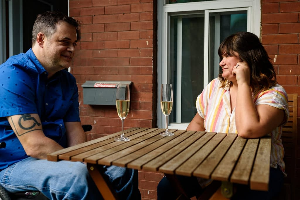 Couple looking at each other at patio table