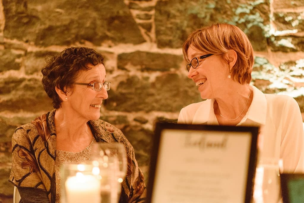 Mother of bride chatting with wedding guest
