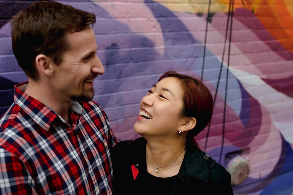 Couple laughing during documentary couples photo shoot