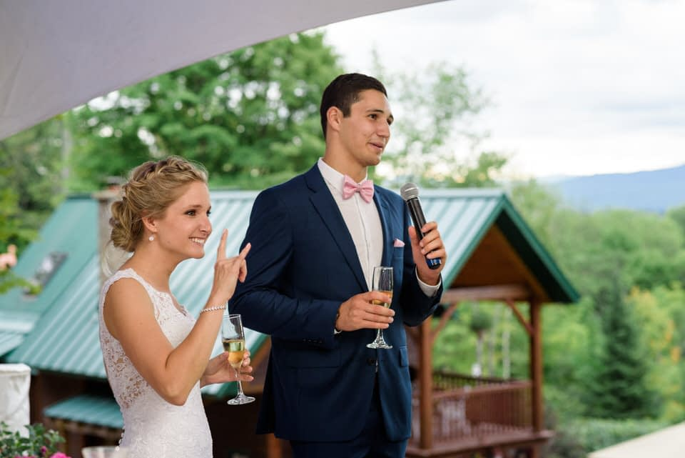 Bride and groom giving welcome speech