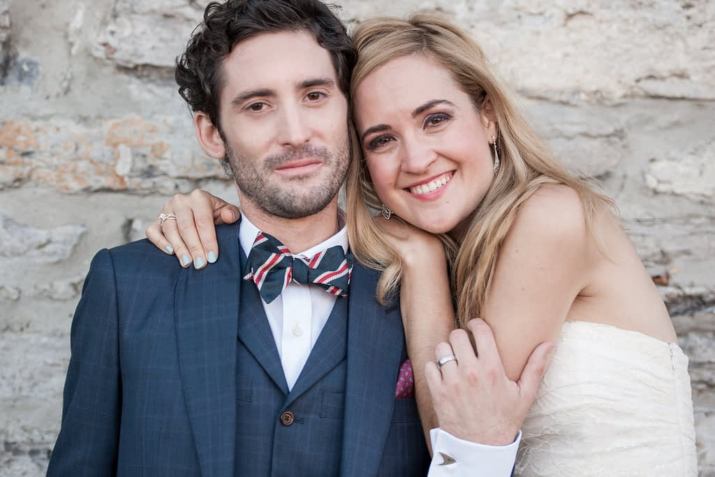 Wedding portrait with stone wall in background
