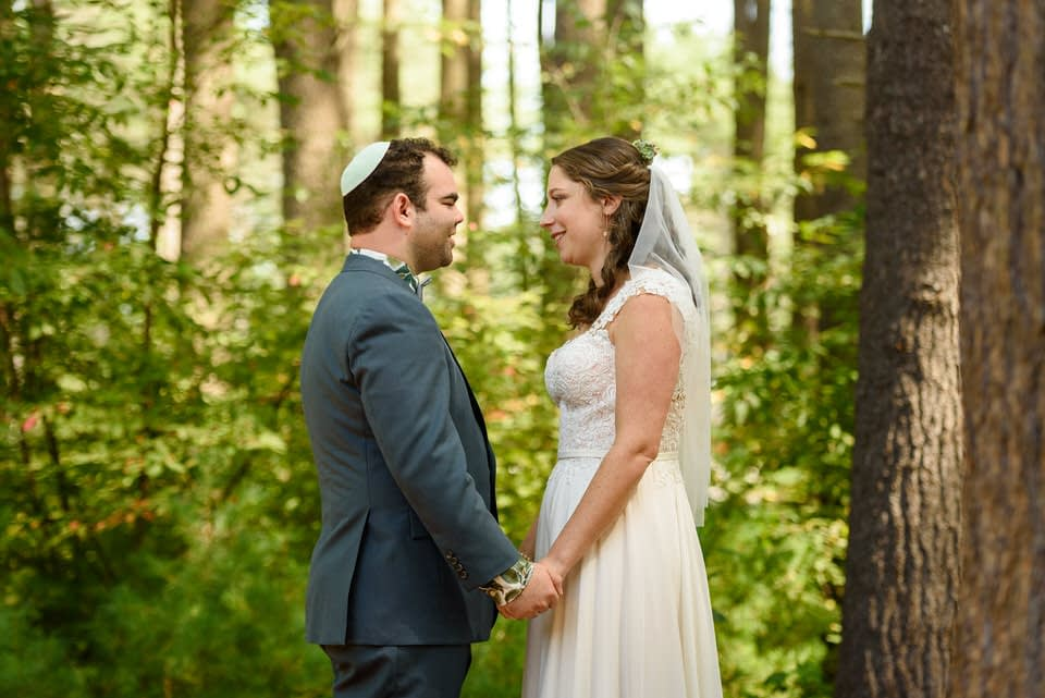 First look photo in the woods on wedding day