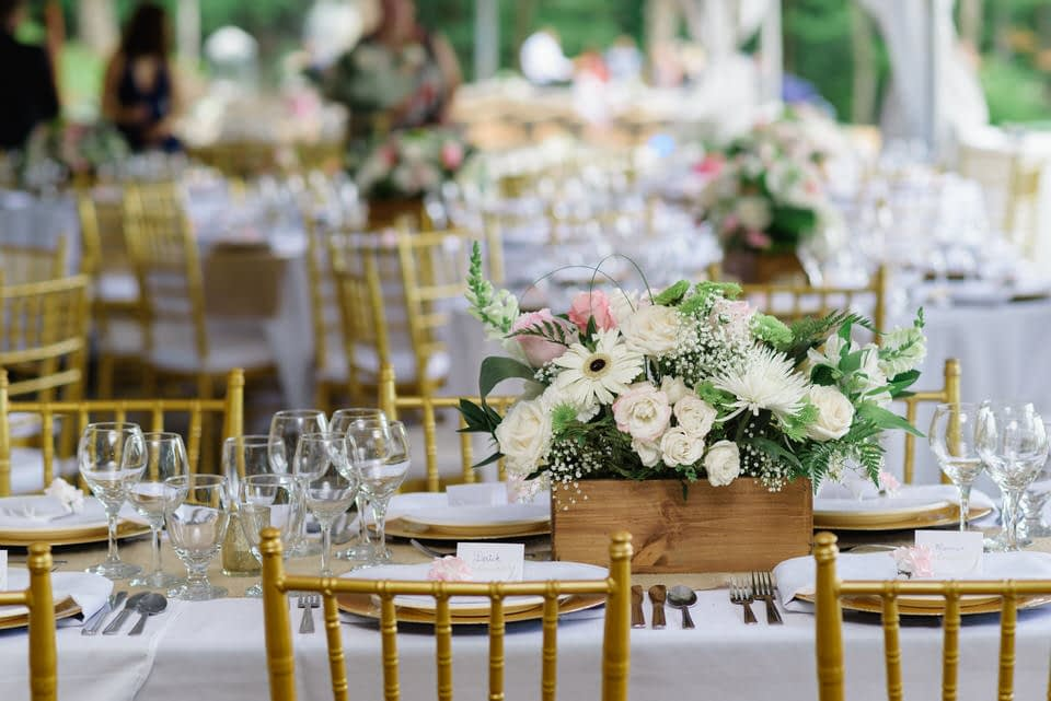 Rustic chic floral centerpiece on outdoor wedding table