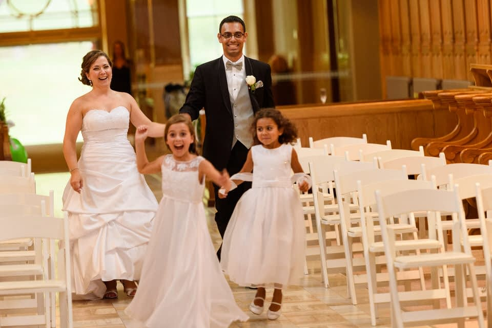 Wedding couple's grand entrance with their kids