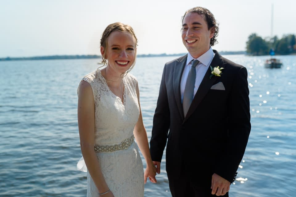 Wedding couple with river behind them