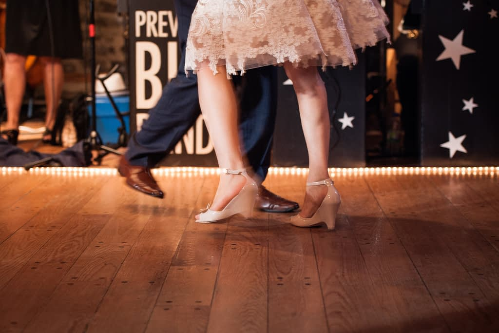 Close up of bride and groom's feet swing dancing