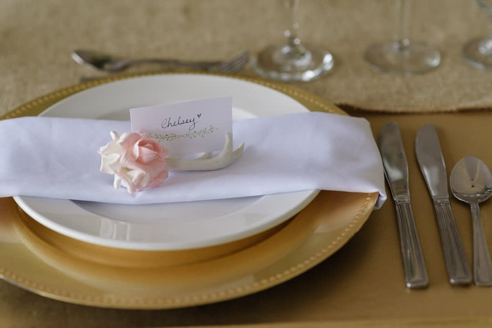 Small ceramic rose and antler wedding place card holder