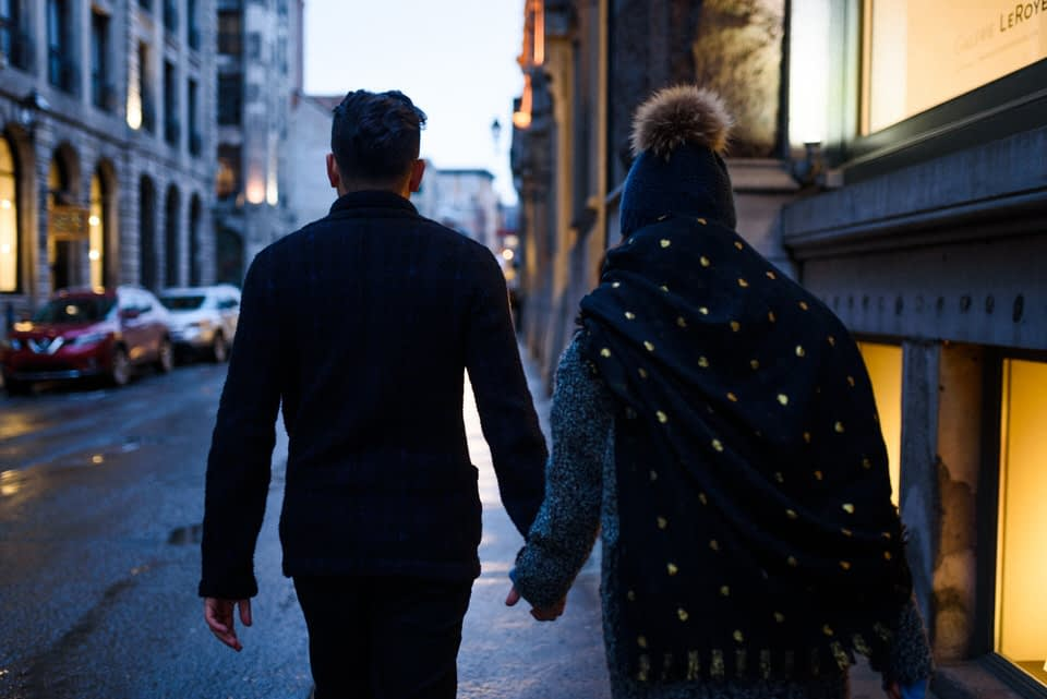Couple walking holding hands in Old Montreal