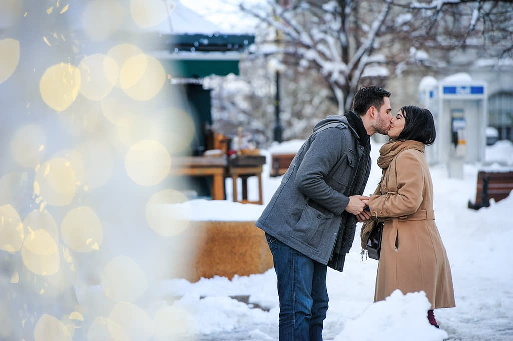 Couple kissing after the surprise proposal