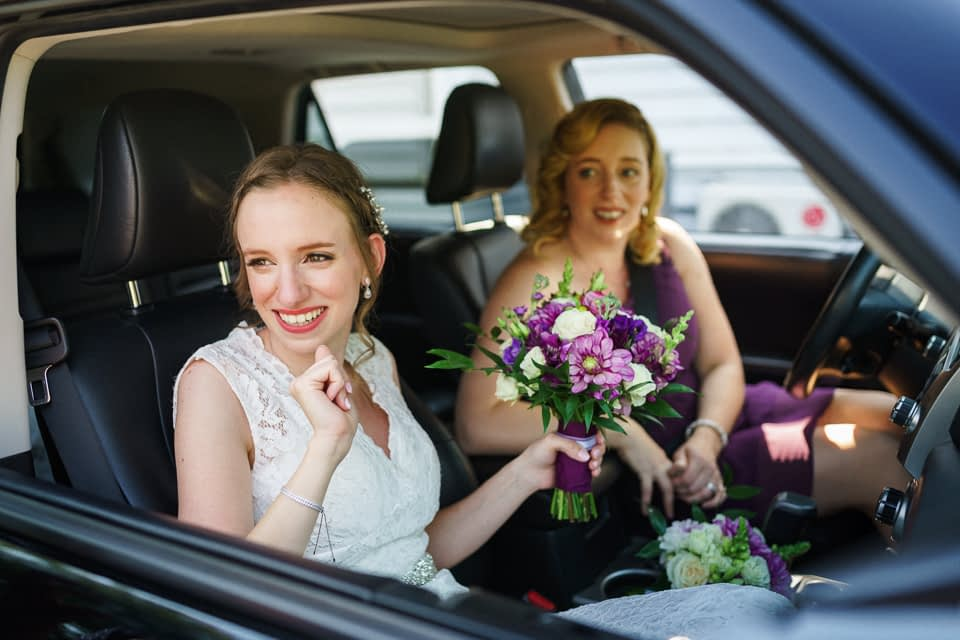 Bride arriving in car with sister