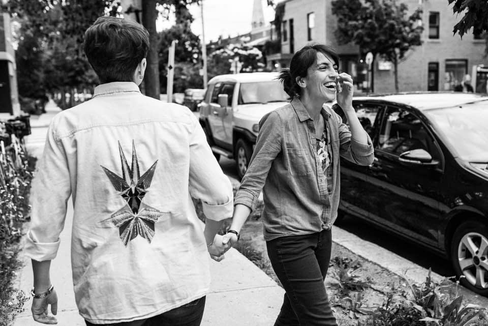 Black and white photo of LGBT couple laughing