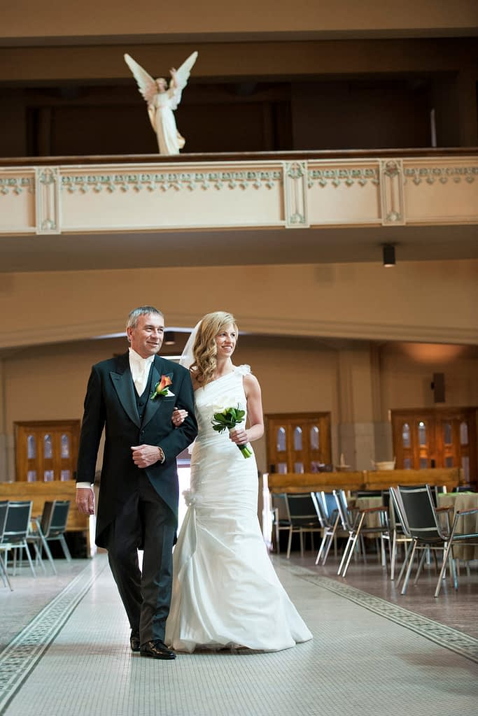 Bride and her father walking into church