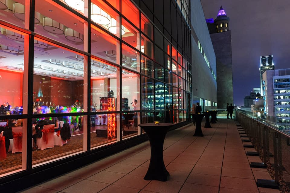 Terrace of Le Westin Montreal reception hall with view of city skyline at night
