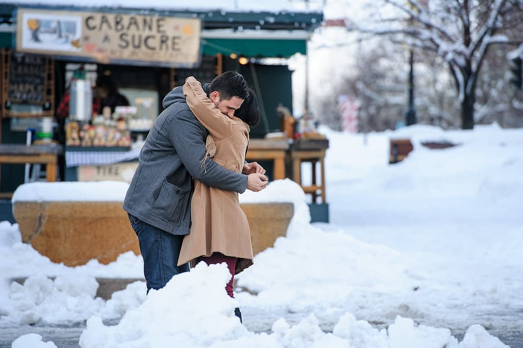Couple hugging after the surprise proposal
