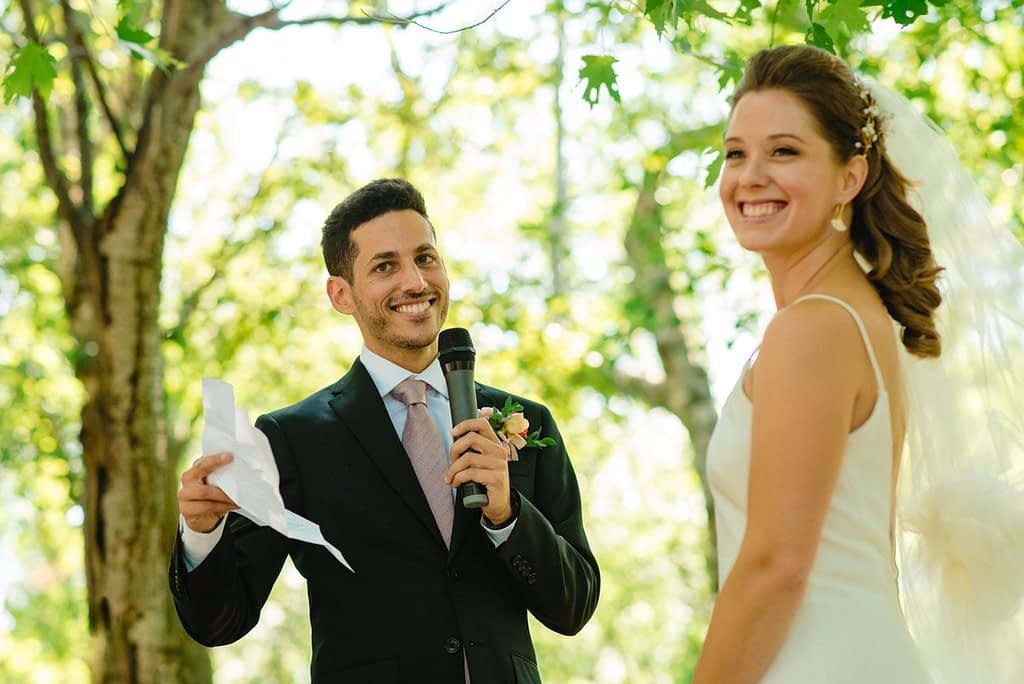 Groom reading his wedding vows at park wedding during the pandemic