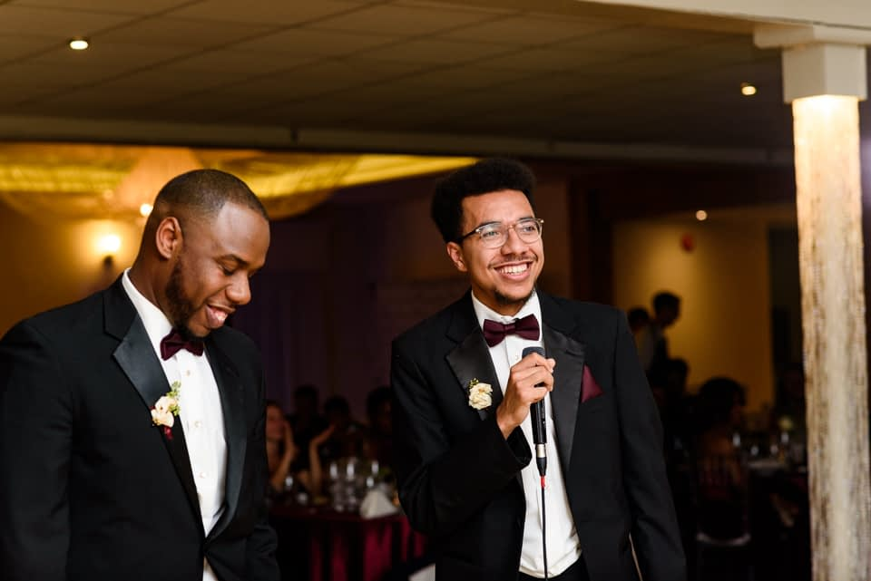 Brothers of the bride giving a speech
