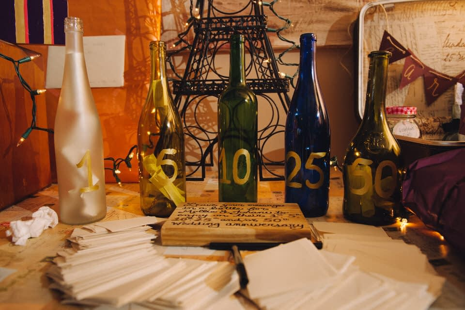 Wine bottles for guests to leave messages in for 5 year anniversary and 10 year anniversary