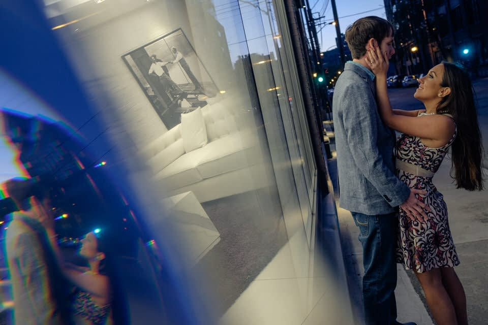 Reflection of couple in window at Griffintown