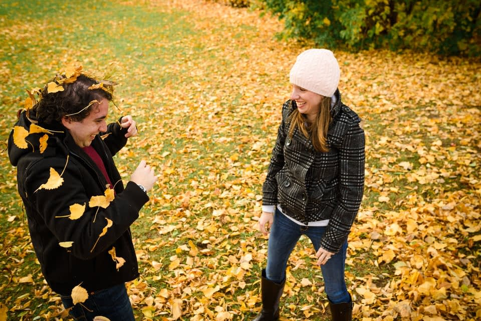 couple has fun with autumnal leaves
